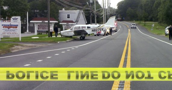 Small plane rolls off runway and onto NY road; no injuries
