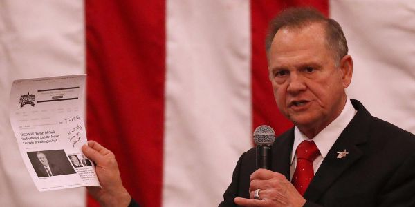Roy Moore and Doug Jones allies make a final push for Alabama voters in dueling election-eve rallies
