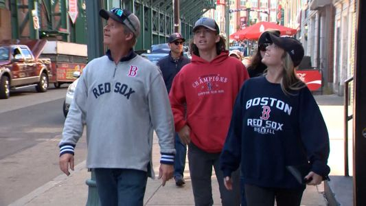Red Sox fans from around country travel to Fenway Park to take in ALCS