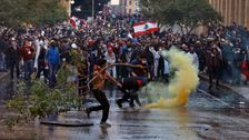 Lebanon Police Fire Tear Gas, Water Cannons At Protesters Amid Riot