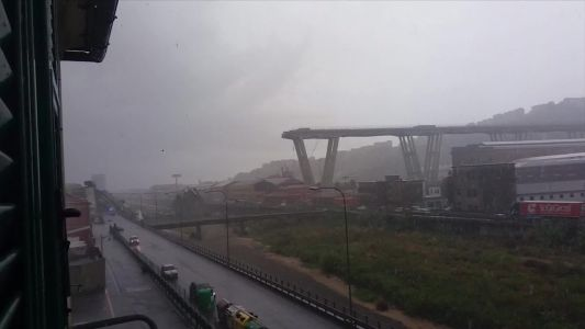 Massive section of bridge collapses during storm in Italy