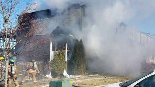 Crews battling three-alarm fire in Baltimore County