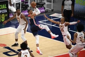 Wizards beat Cavaliers 120-105, clinch East play-in spot