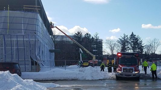 Firefighters help man down ladder after injury at Wauwatosa construction site