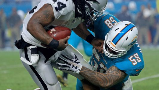 Dolphins release Rey Maualuga after arrest for battery