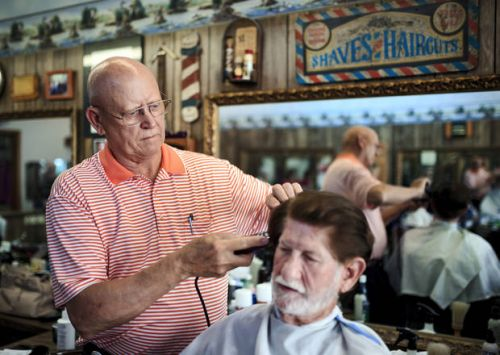 Barber adjusts to hairstyle changes through the decades