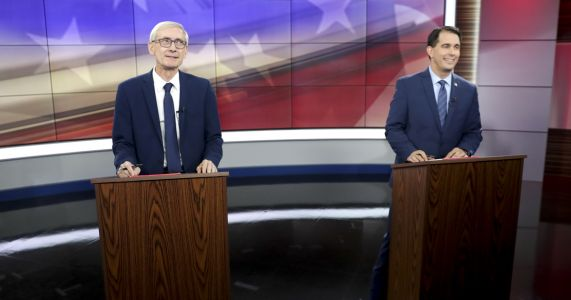 Walker, Evers deliver sharp attacks in first debate