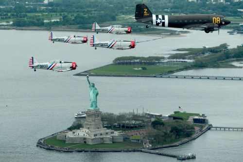 Vintage planes soar over Lady Liberty in spectacular display