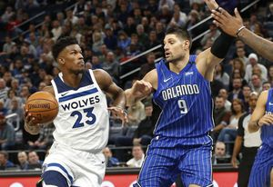 Butler ties season high with 26, Wolves beat Magic 124-118