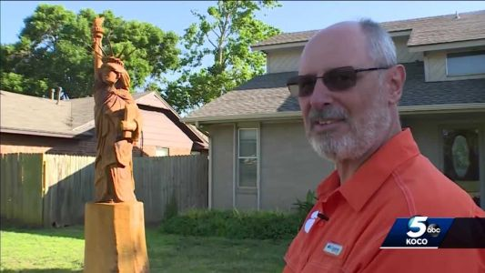 'A beacon for all to see': Naturalized citizen transforms damaged tree into Statue of Liberty