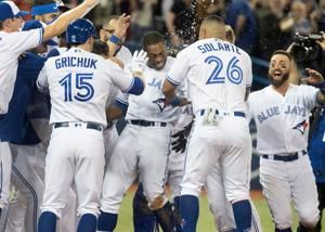 Granderson's HR lifts Blue Jays past Red Sox on somber night