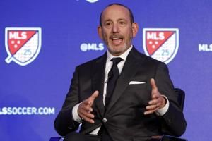 AP Source: MLS cutting pay of top executives, some staff
