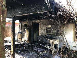 Cell phone user calls in Midtown house fire in Tucson
