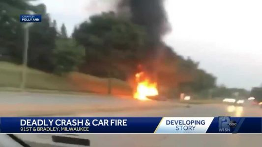 A driver was killed after a fiery crash that split a car in two