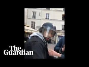 Macron's security aide detained, was filmed beating activist