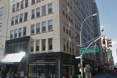Pricey office condo by City hall goes up for sale