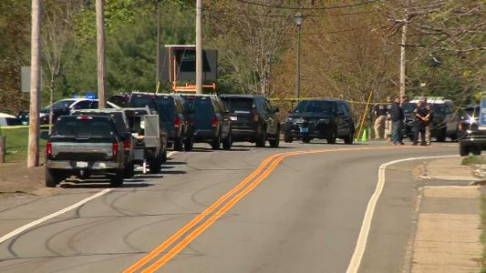 Police shooting in Massachusetts as man drives SUV into station
